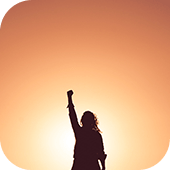 Person silhouette with fist in the air